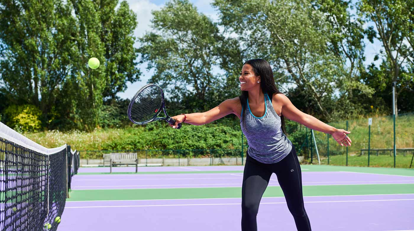 Image of lady playing backhand volley