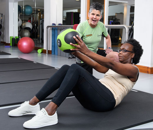 Image of lady with medicine ball during PT session