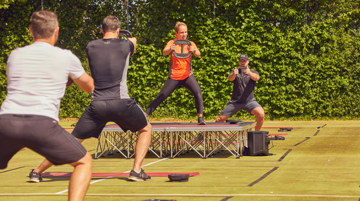 Image of group doing outdoor bodypump class