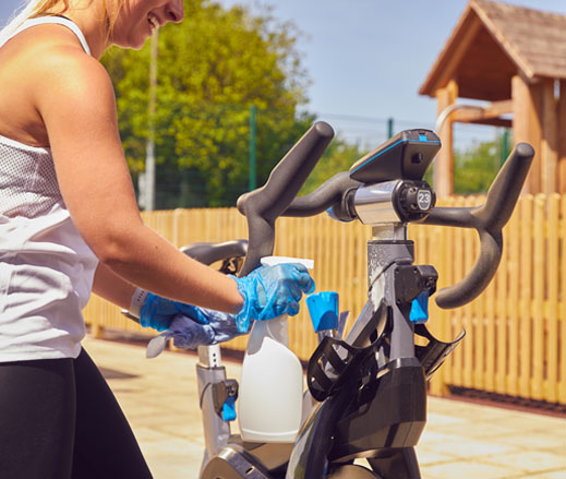 Image of outdoor lady cleaning bike at David Lloyd